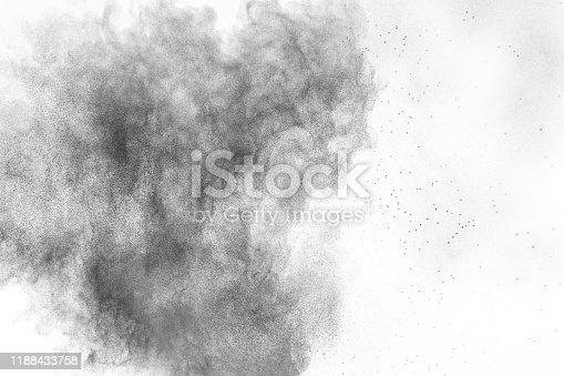 872058828 istock photo Black powder explosion against white background.Charcoal dust particles cloud in the air. 1188433758