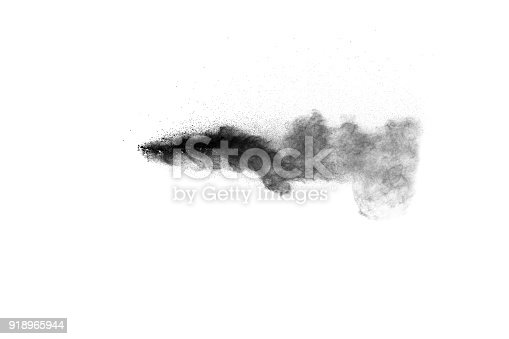 909122710 istock photo Black powder explosion against white background.The particles of charcoal splatted on white background. Closeup of black dust particles explode isolated on white background. 918965944