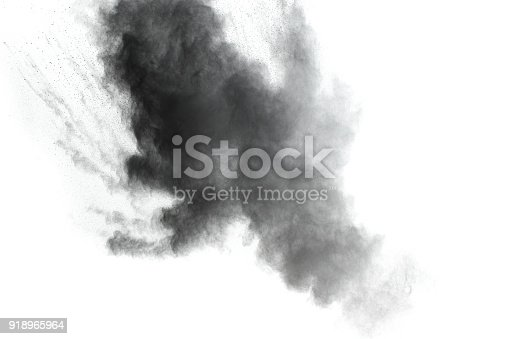 istock Black powder explosion against white background.The particles of charcoal splatted on white background. Closeup of black dust particles explode isolated on white background. 918965964