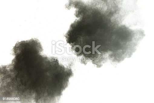 909122710 istock photo Black powder explosion against white background.The particles of charcoal splatted on white background. Closeup of black dust particles explode isolated on white background. 918966080