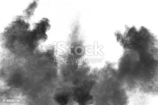 909122710 istock photo Black powder explosion against white background.The particles of charcoal splatted on white background. Closeup of black dust particles explode isolated on white background. 918966108