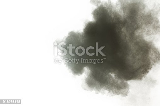 909122710 istock photo Black powder explosion against white background.The particles of charcoal splatted on white background. Closeup of black dust particles explode isolated on white background. 918966148