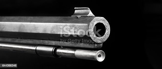 Front end of old 50 caliber black powder riffle black and white with room for your type.