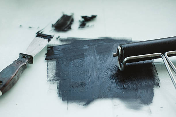 Black printmaking ink with roller and spatula