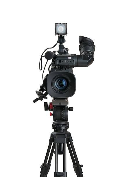 Black professional digital video camera and tripod on white stock photo