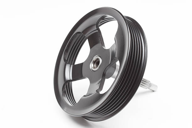 Black pulley car engine on a gray background stock photo