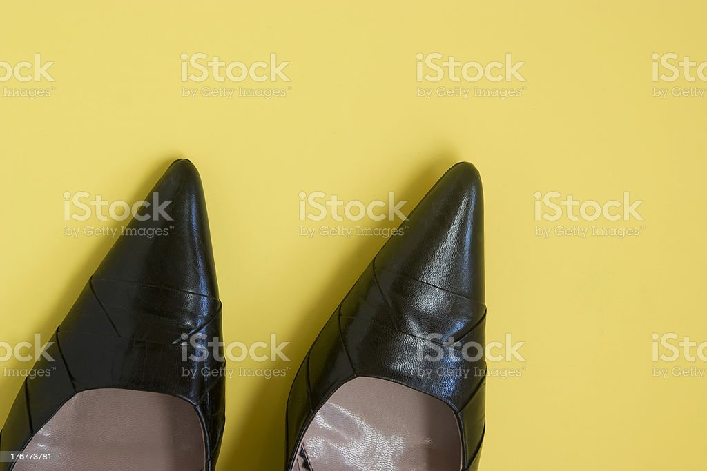 Black Pumps against a yellow background royalty-free stock photo