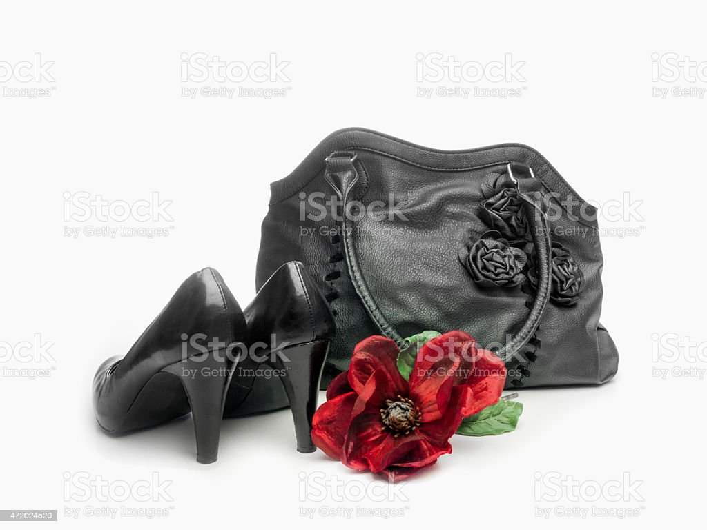 black pumps and purse and faux flower stock photo
