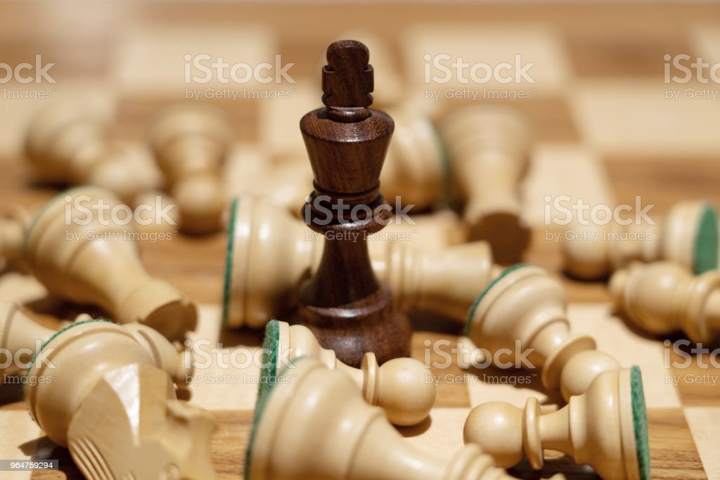 black queen  win against with team in chess game for business concept royalty-free stock photo