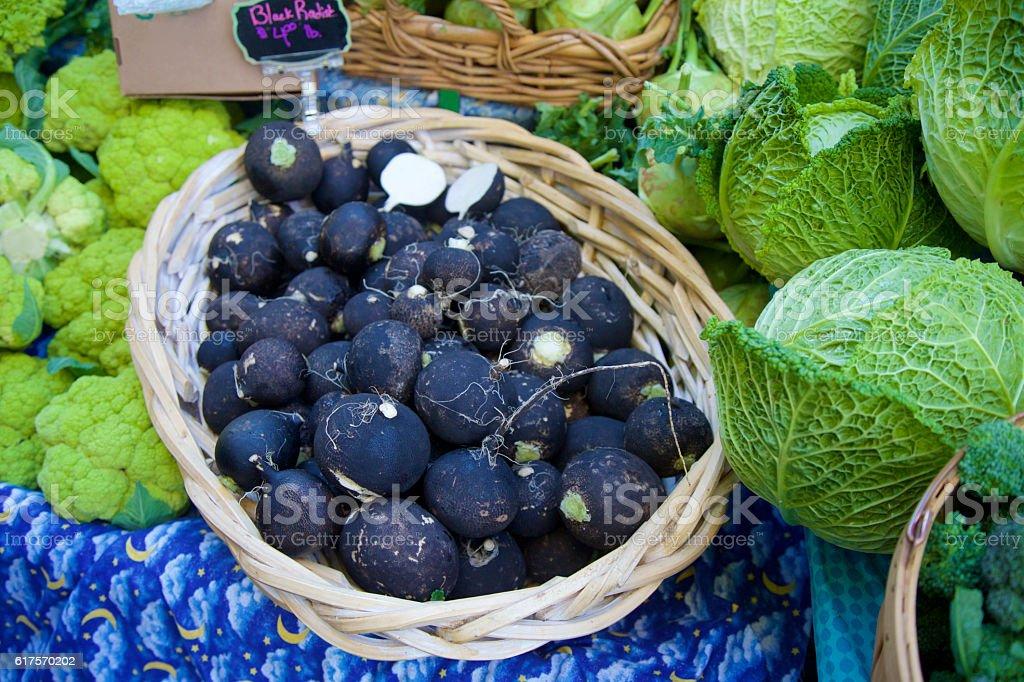 Black Radish Black radish at the farmer's market Agricultural Fair Stock Photo