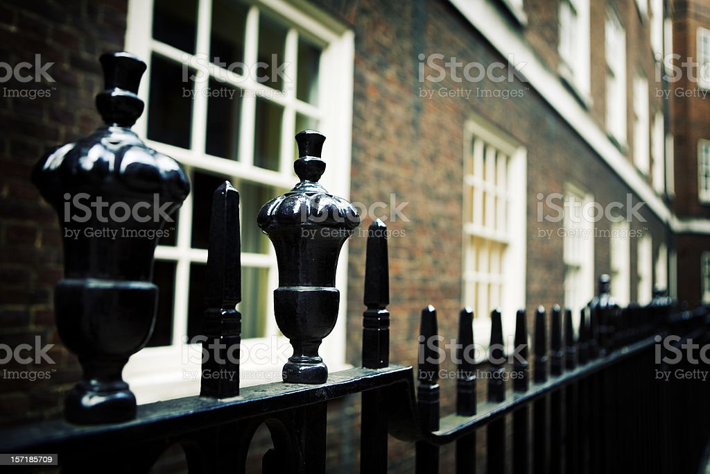 Black railings fronting a Georgian period building, London, UK royalty-free stock photo