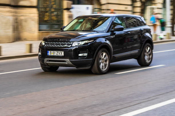 Black Range Rover  in motion in traffic of downtown of Bucharest, Romania, 2020. Black Range Rover  in motion in traffic of downtown of Bucharest, Romania, 2020. range rover stock pictures, royalty-free photos & images