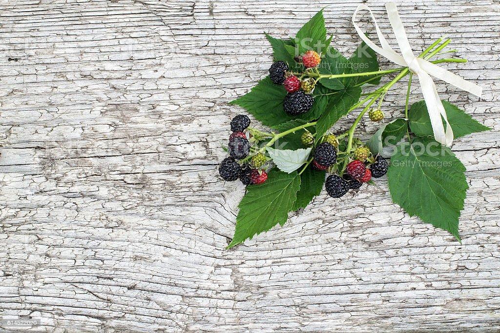 Black raspberries (Rubus occidentalis) on the wooden background stock photo