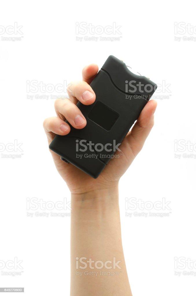 black rectangular taser in hand isolated on white stock photo