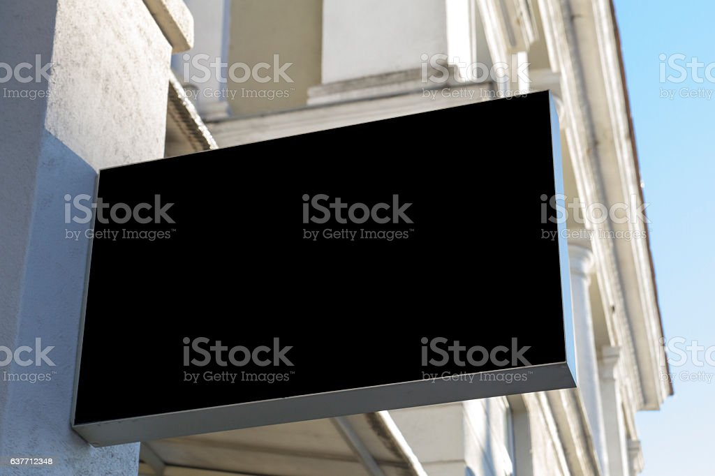 Black restangular signboard on the wall. Mock up stock photo