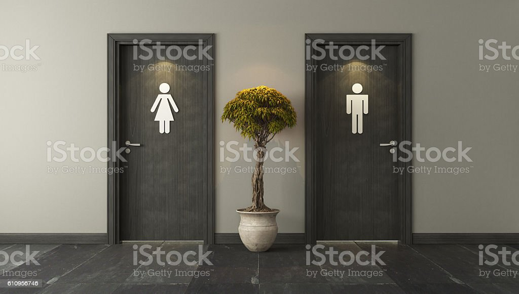 black restroom doors for male and female stock photo