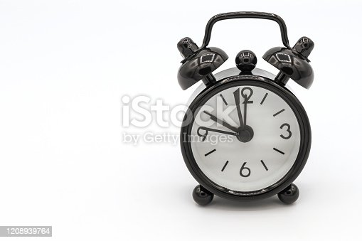 1183352589 istock photo A black retro alarm clock isolated on white background. 1208939764