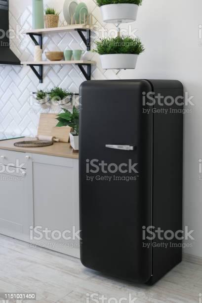 Black retro design fridge in white wooden kitchen picture id1151031450?b=1&k=6&m=1151031450&s=612x612&h=bya fteep3x8kgkih2q3bmyofnentkpb3xxlakza97c=