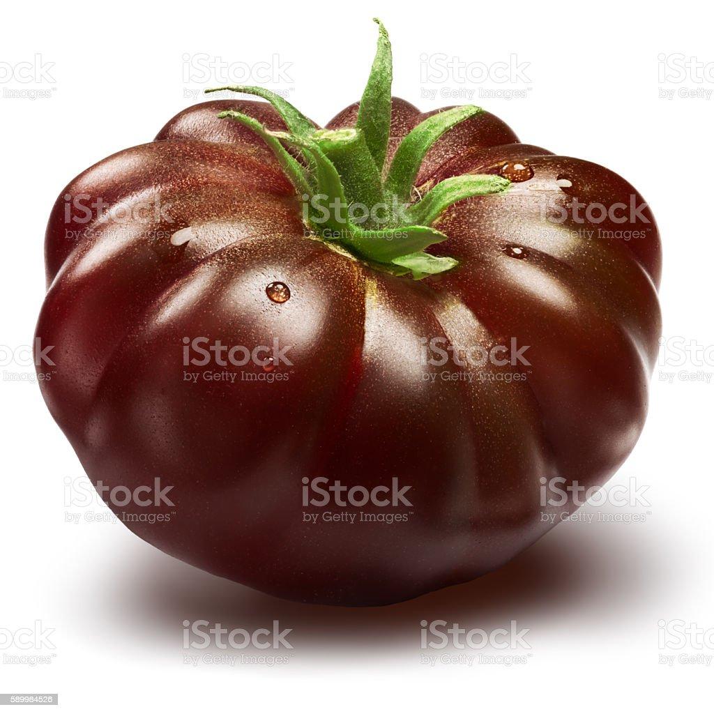 Black ribbed heirloom tomato, paths stock photo