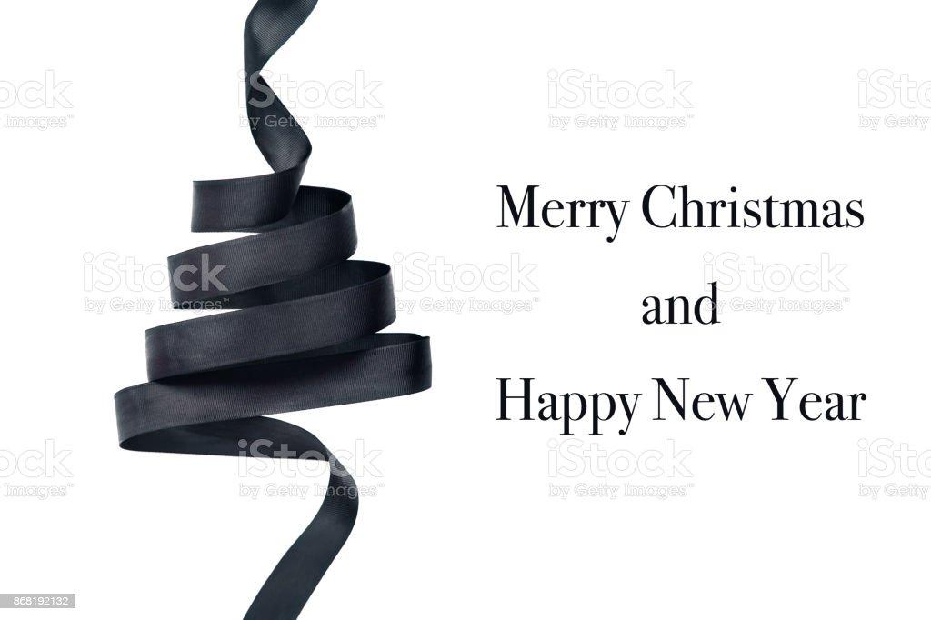 Black ribbon in shape of Christmas tree stock photo