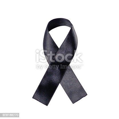 istock Black ribbon on a white background. Folded ribbon. Close up 928188270