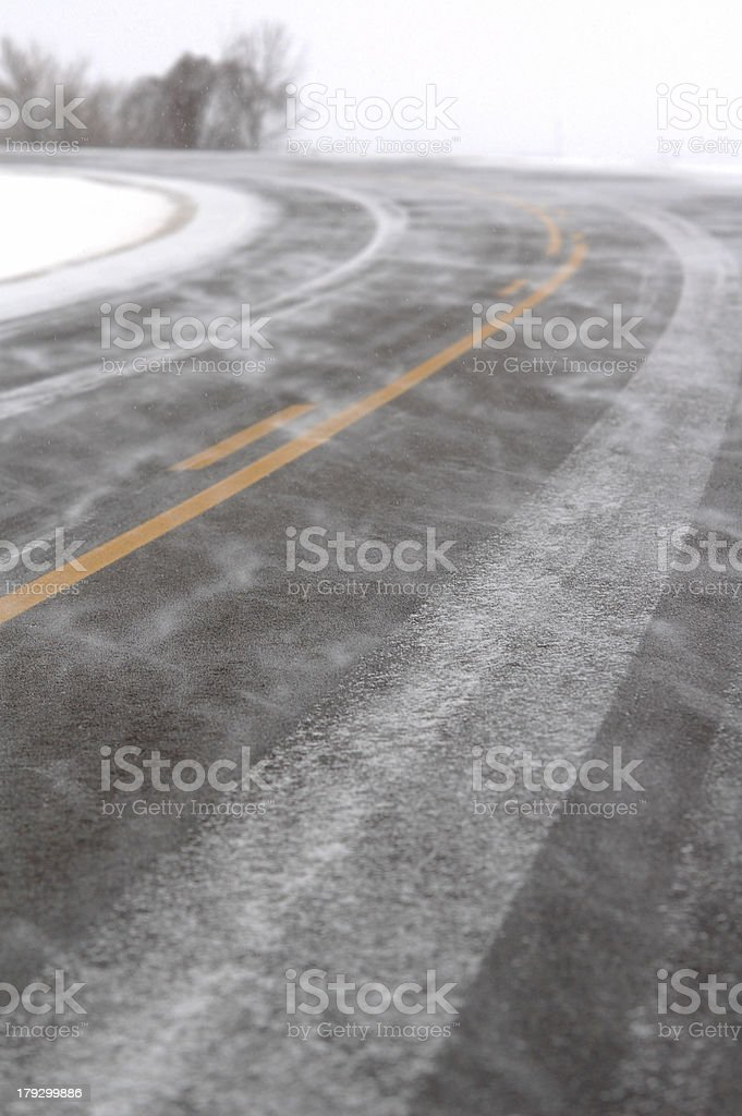 Black Road Covered in Snow stock photo