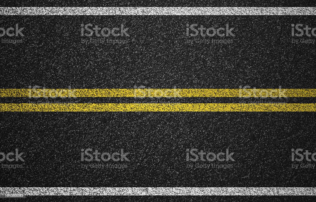 Black road graphic with yellow central marking and white stock photo