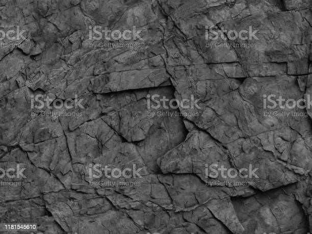 Photo of Black rock background. Mountain close-up. Gray stone background. Bright black grunge background.
