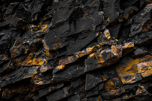 black rock background with golden / yellow color