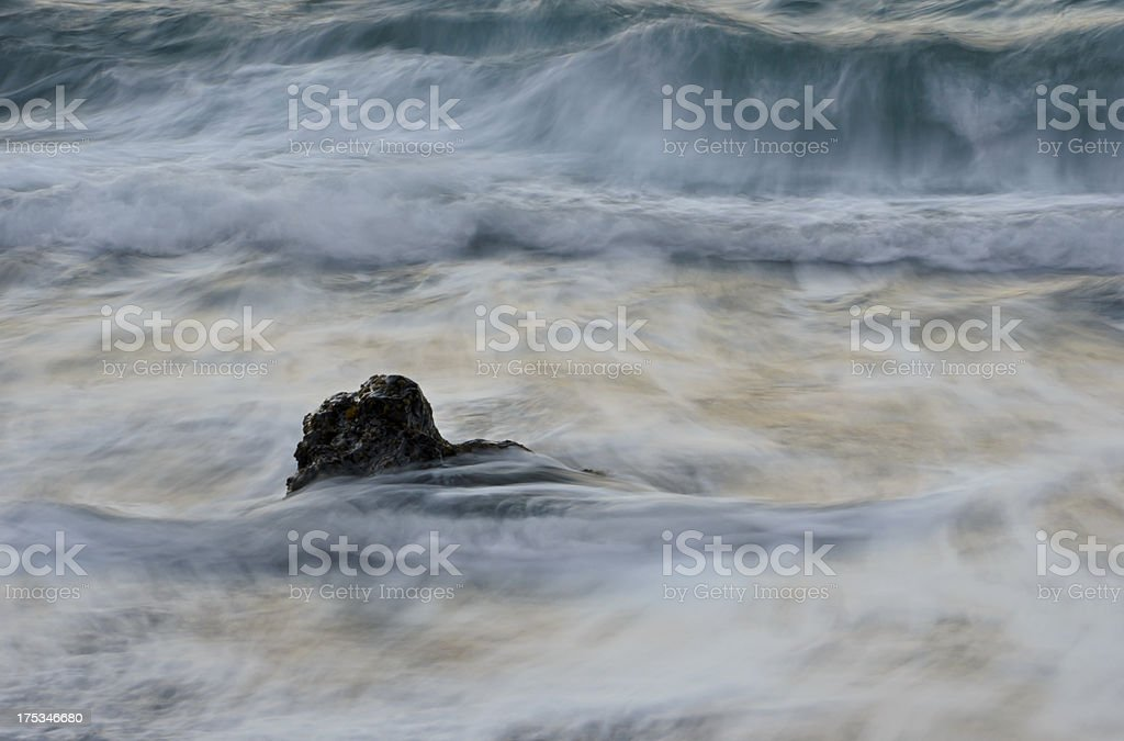 Black Rock in the Waves royalty-free stock photo