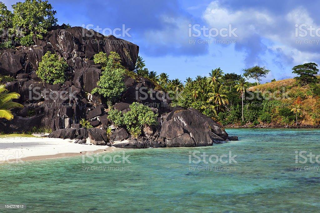 Black rocks. Bora-Bora. Polynesia stock photo