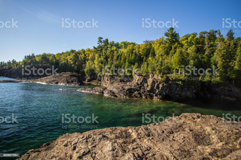 Black Rocks On Lake Superior In Marquette Michigan Presque Isle Park stock photo