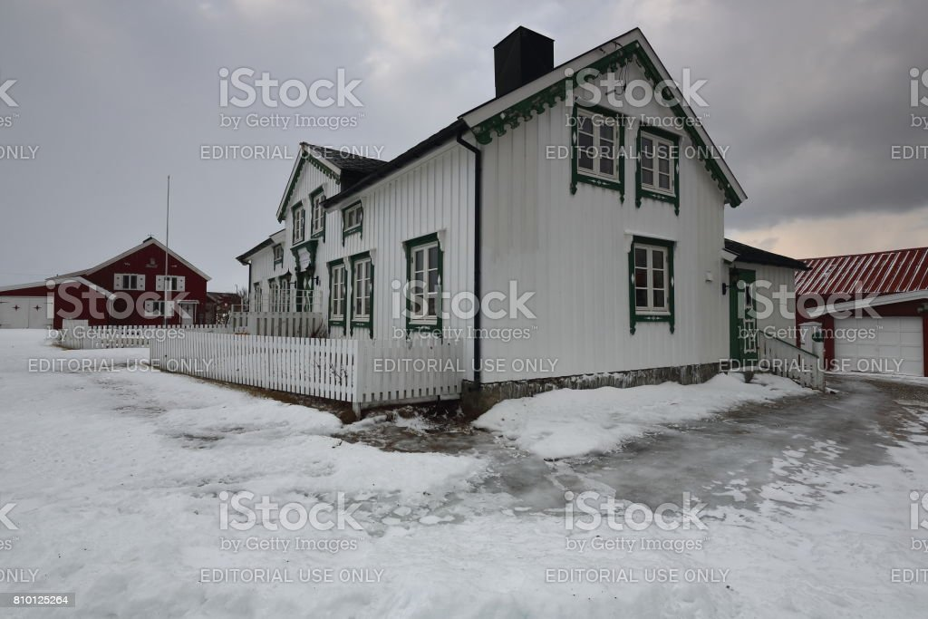 Black roofed white house-green windows and doors. Nordmela-Andoya island-Norway. 0057 stock photo