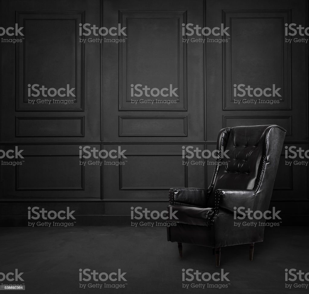 Black room interior design with armchair stock photo