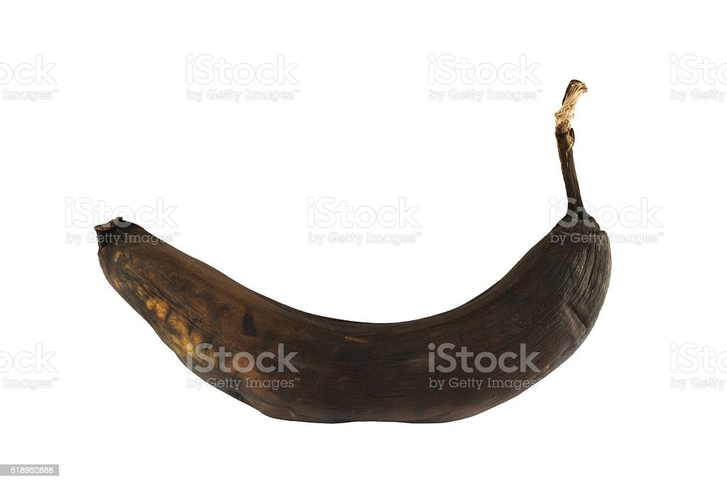 Black rotten banana isolated stock photo