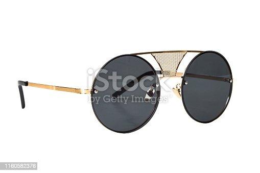1047544590 istock photo Black round Sunglasses 1160582376