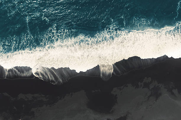 black sand beach at iceland black sand beach at iceland from 350m via drone black sand stock pictures, royalty-free photos & images
