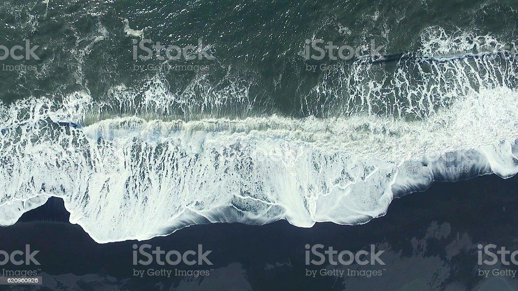 black sand beach at iceland stock photo