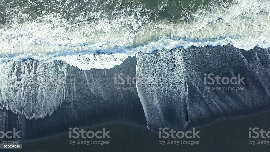 black sand beach at iceland stock photo