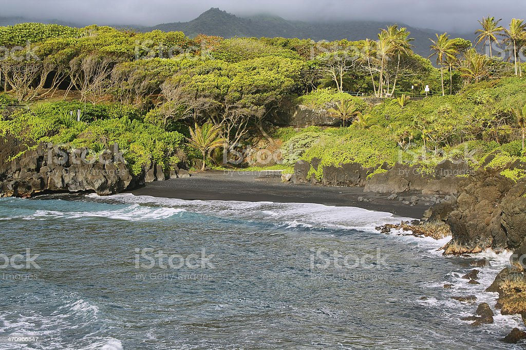 Black sand beach views in Waianapanapa State park stock photo