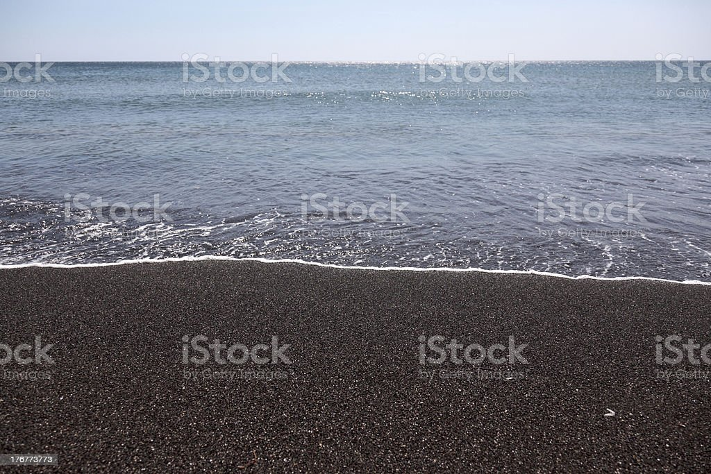 Black Sand Beach with Calm Sea royalty-free stock photo