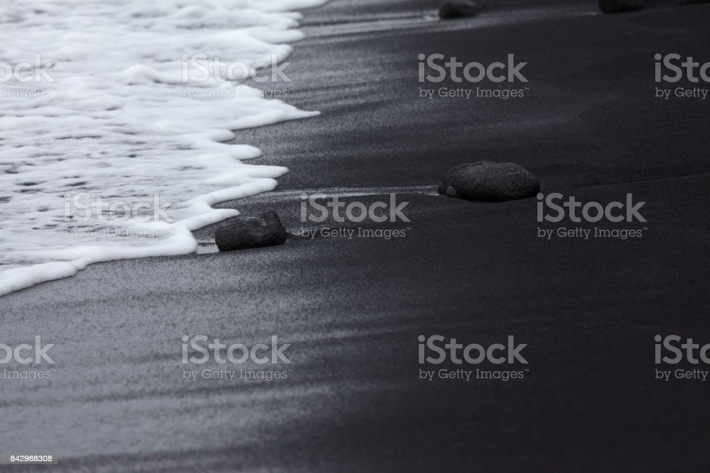 Black Sand Beach with white wave at Punalu'u, Hawaii stock photo