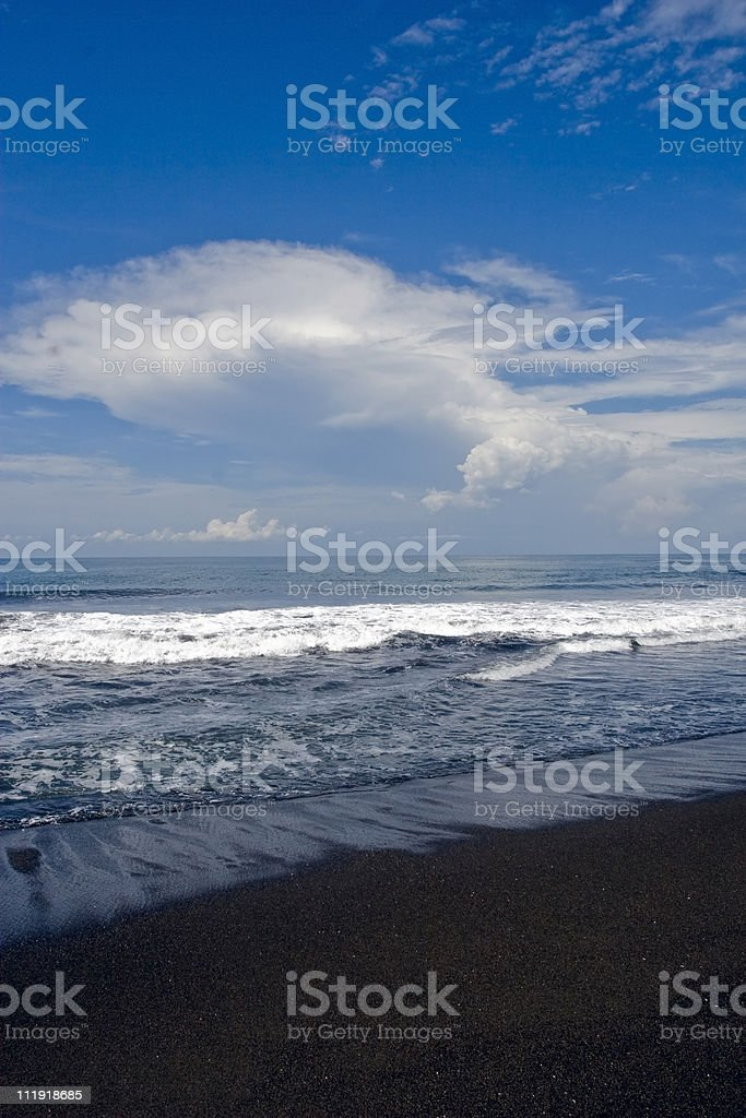 Black sand Guatemala beach sky and surf royalty-free stock photo