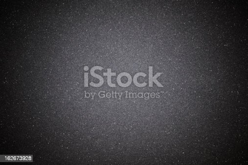 istock Black sand texture background with spotlight 162673928