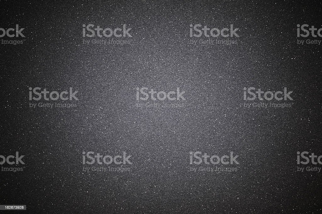 Black sand texture background with spotlight stock photo