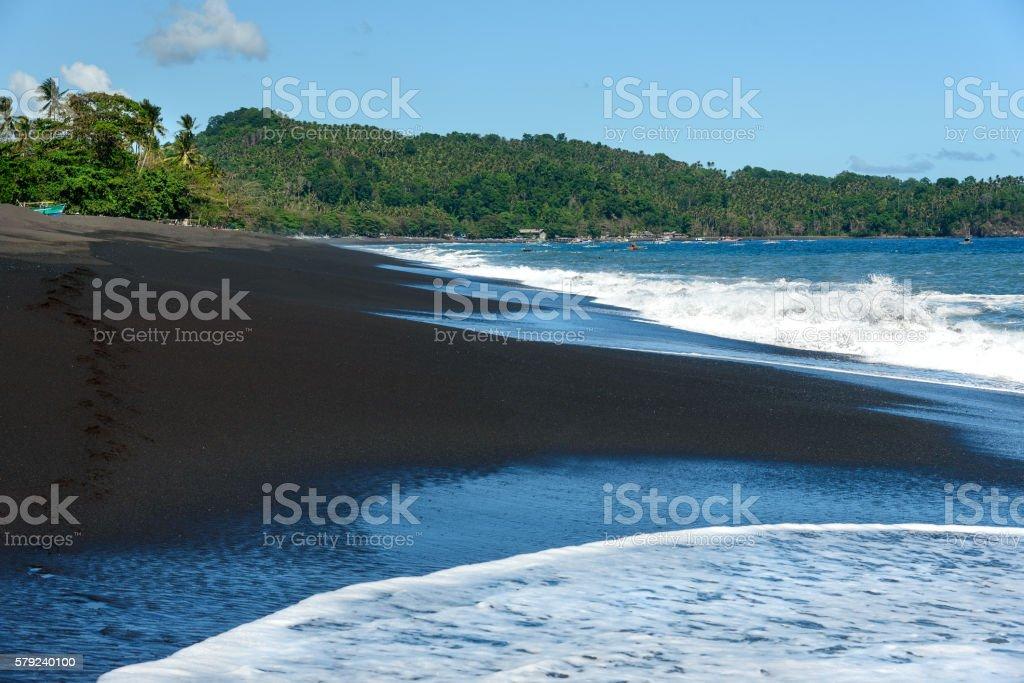Black sand volcanic beach stock photo