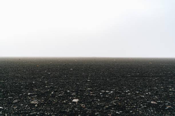 Black sand white sky iceland volcanic desert stock photo