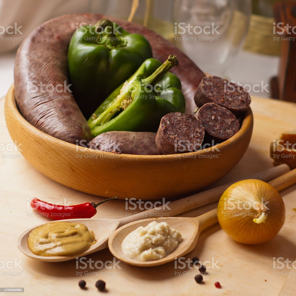 Black sausage Black pudding sausage, bloody sausage Haggis-  sausage made from blood -  traditional homemade. Black Pudding Stock Photo