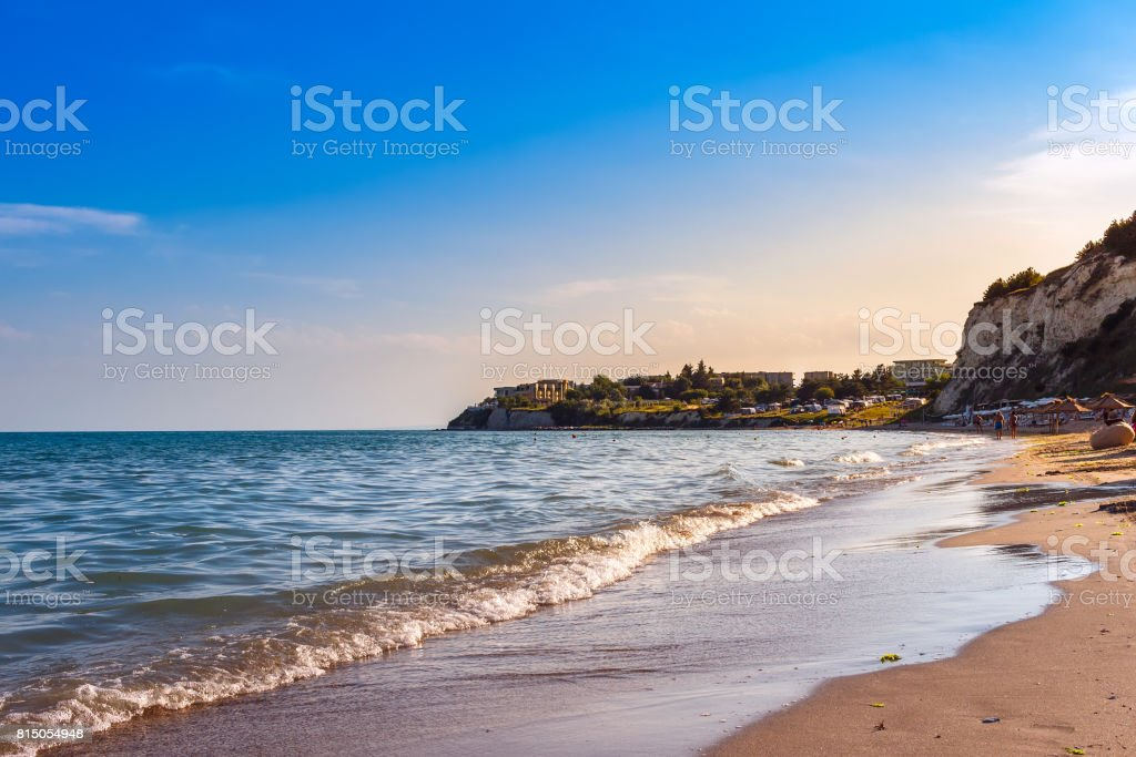 Black sea coast with sand beach in Bulgaria, at suset, summer sea rest concept stock photo