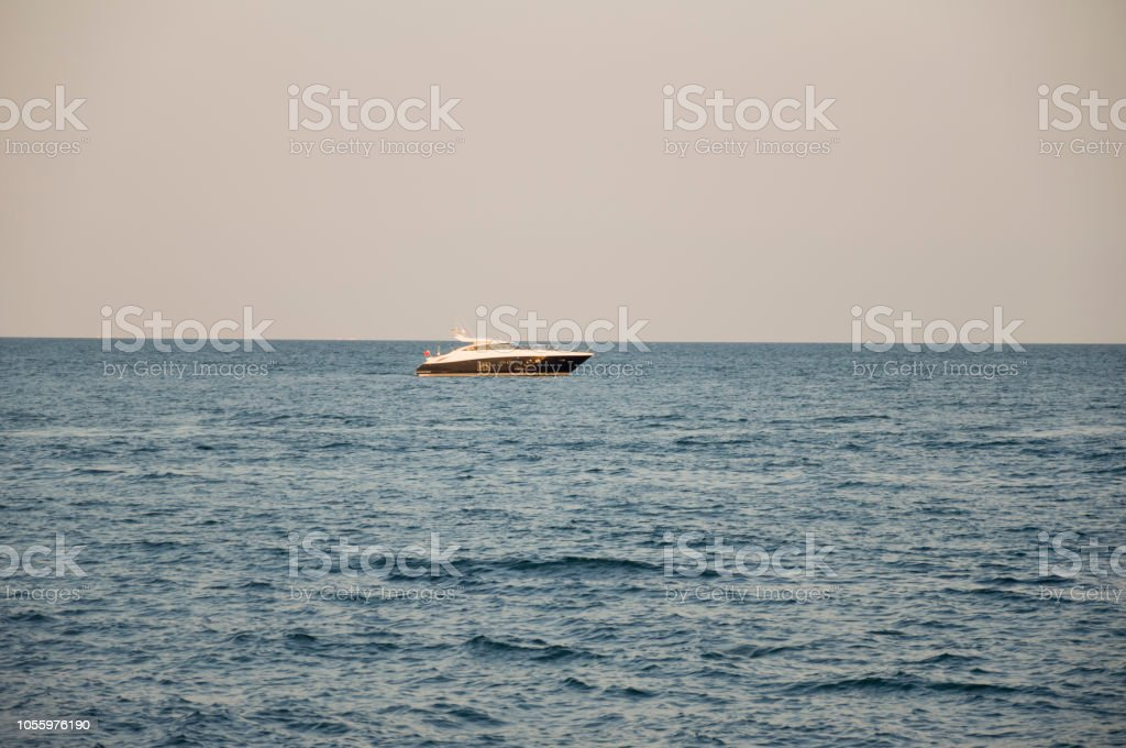 Black Sea Water With No Waves And Little Boat Far Away Big